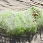 "~33"" around and stretchy to fit most sizes, I made this tutu with white and light green tule fabric and sewed on silk orchids for a little extra decoration. $12 - Send payment via PayPal to megan@meganpru.com with the item name to purchase. Thank you!"