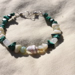 "Small ~6.5"" bracelet on nylon-coated wire string, wire clasps and various gemstone beads including green malachite, shells, moonstone, and coral.  $7.50 - Send payment via PayPal to megan@meganpru.com with the item name to purchase."