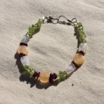 "Small ~6"" bracelet on nylon-coated wire string, wire clasps and various gemstone beads including citrine, moonstone, garnet, and peridot.  $7.50 - Send payment via PayPal to megan@meganpru.com with the item name to purchase."